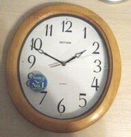 Настенные часы Rhythm CMG271NR07 овальные