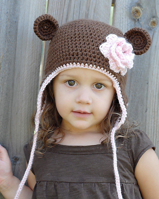Теплая детская шапка с ушками вязаная спицами для мальчика 70