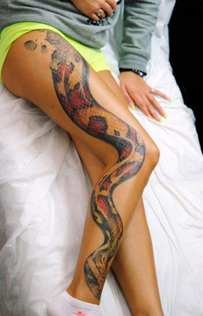 Фото тату змея вокруг ноги