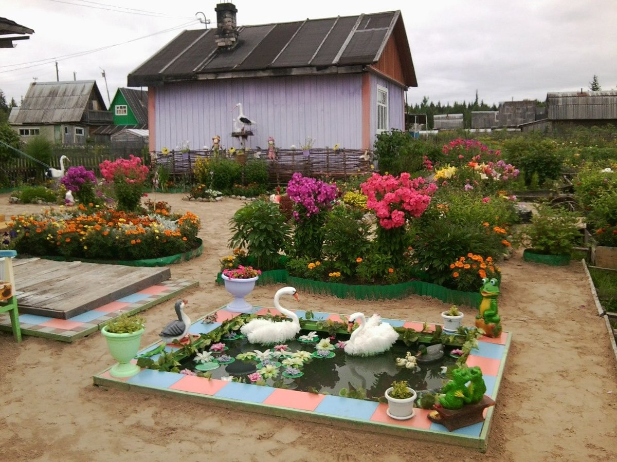 Обустройство двора дома в деревне своими руками  21