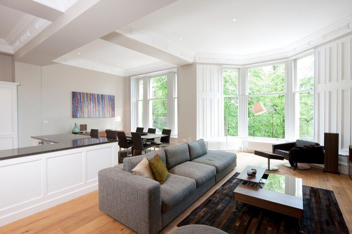 Дизайн гостиной с эркером совмещенной с кухней