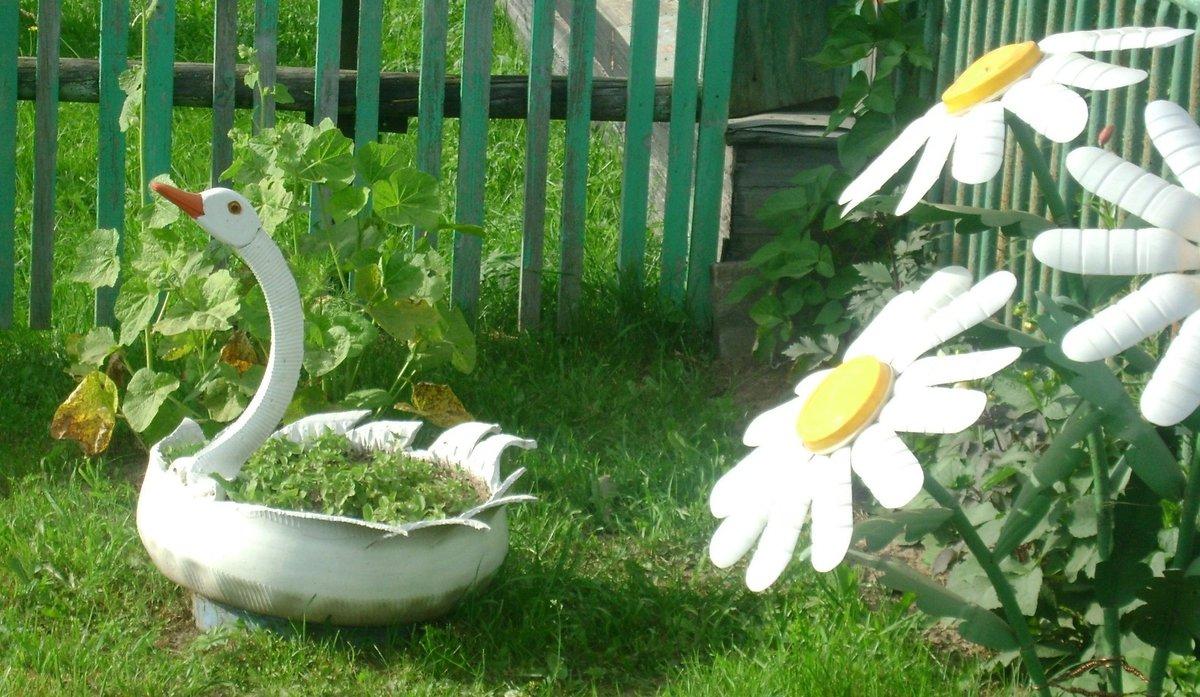 Поделки из дисков для дачи. Как украсить двор и огород? 79