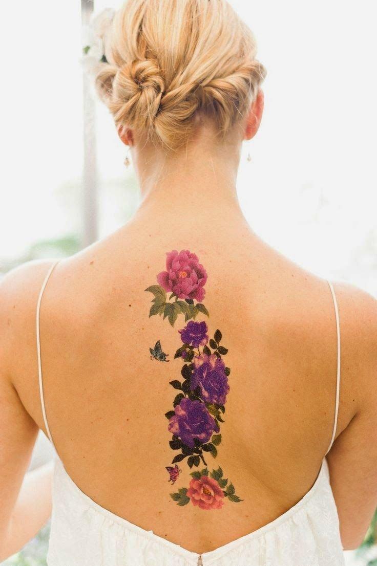 Татуировки цветы на пояснице для девушек