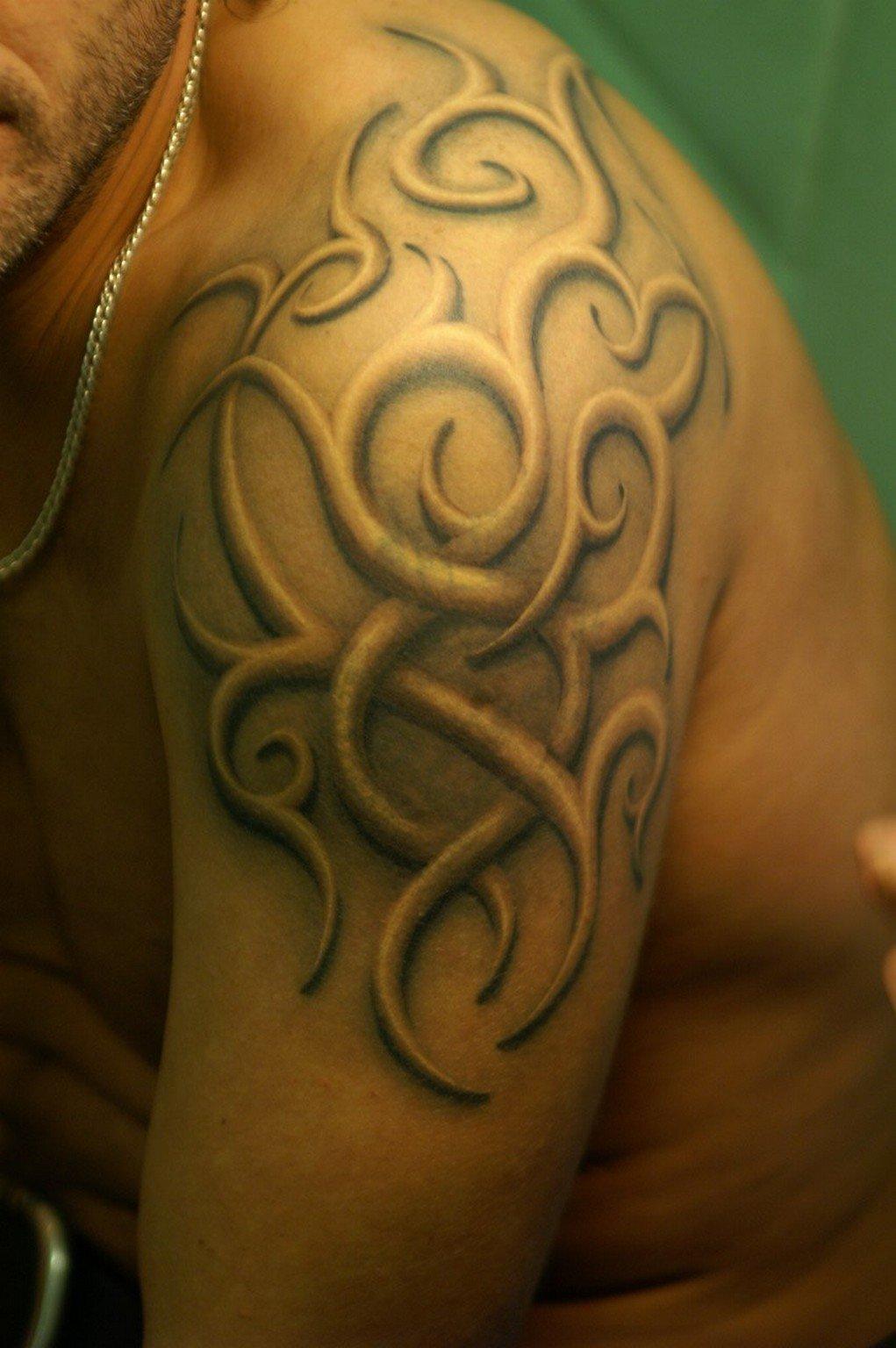 Татуировки фото на руке трайбл