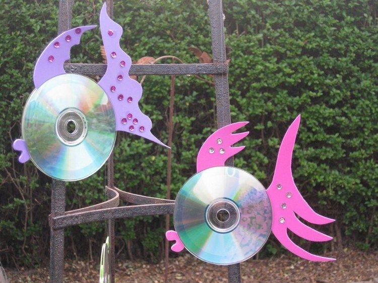 Что сделать из дисков для дачи своими руками 163