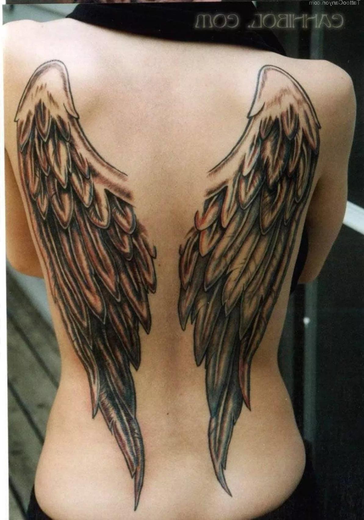 Фото татуировки с крыльями на спине