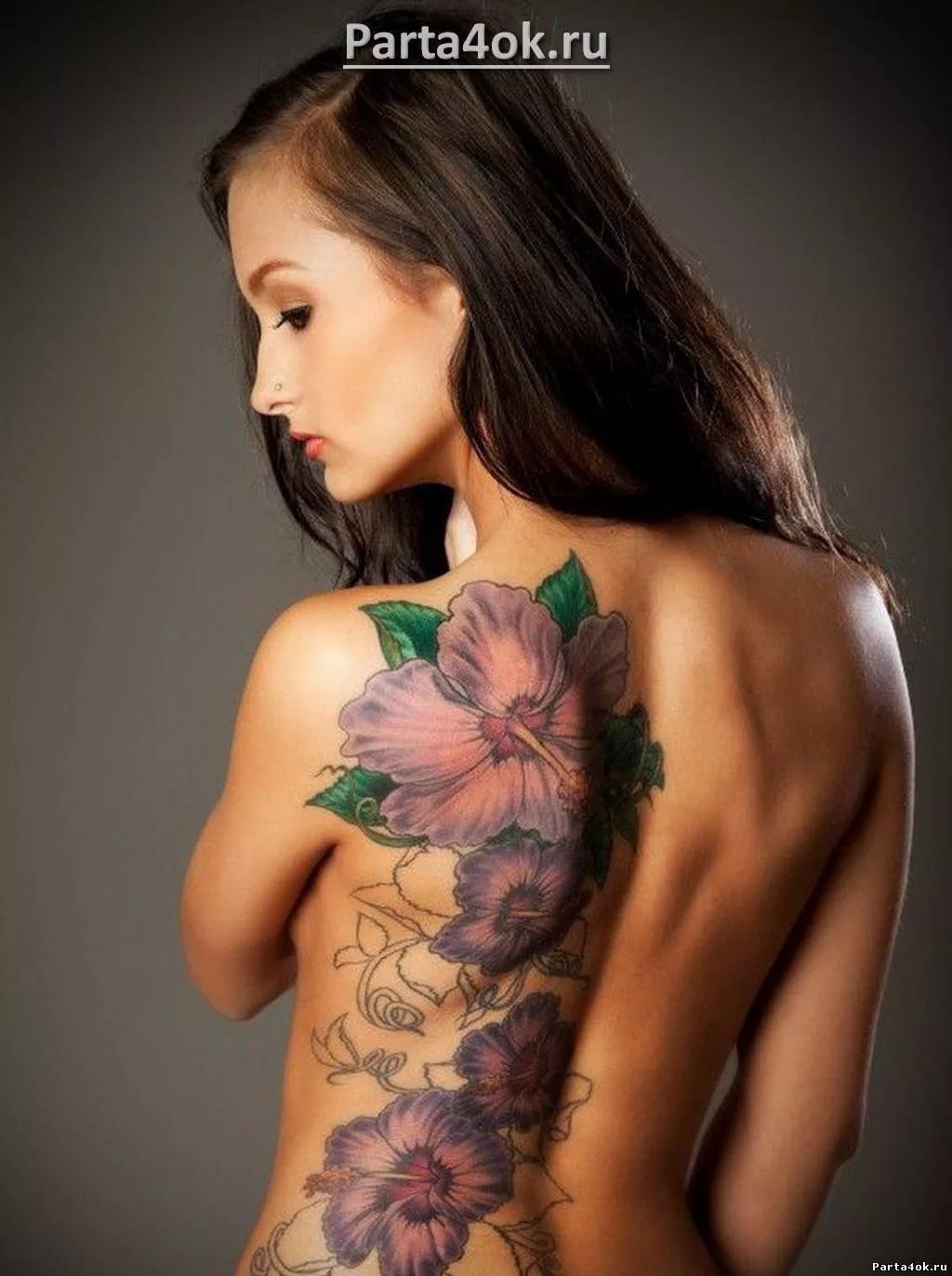 Фото татуировка на женском теле