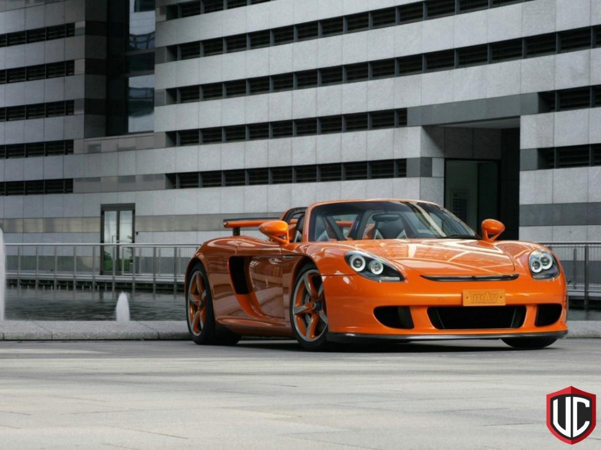 Оранжевый автомобиль porsche carrera  № 836983  скачать