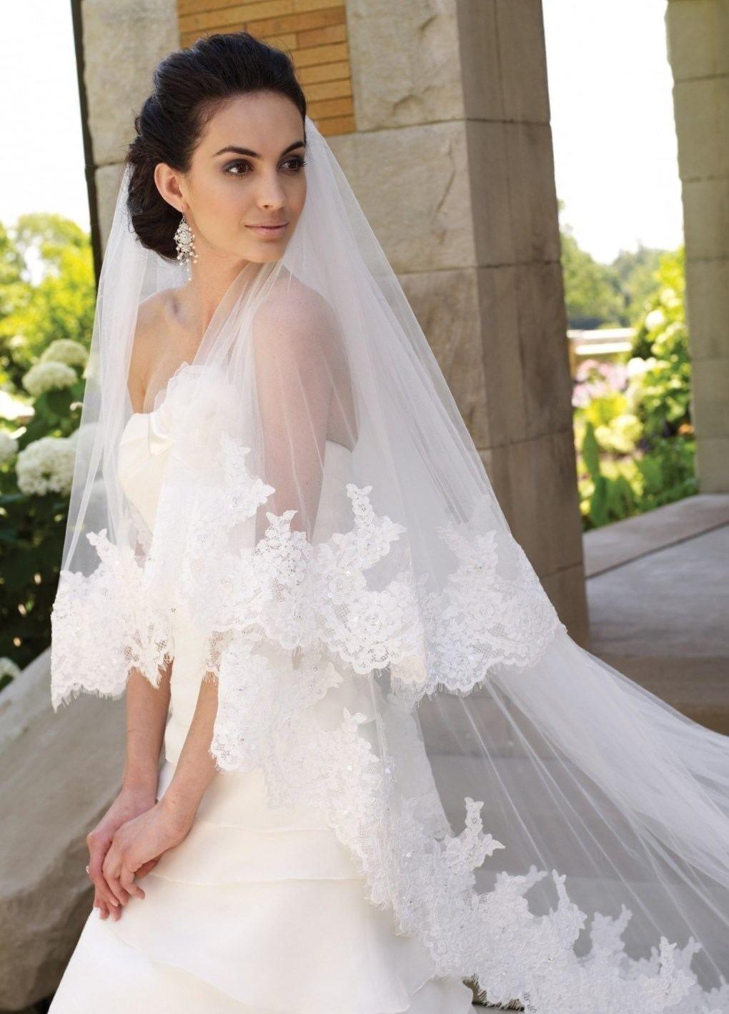 Прическа невесты длинная фата фото