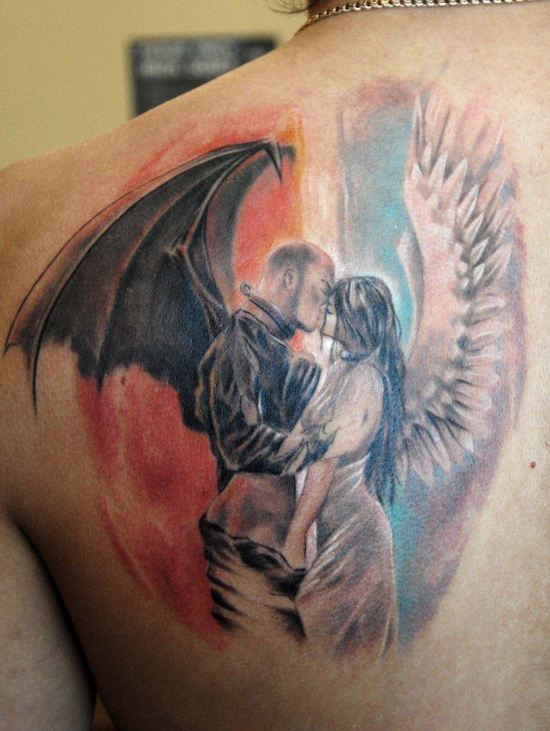 Тату в виде ангела с демоном