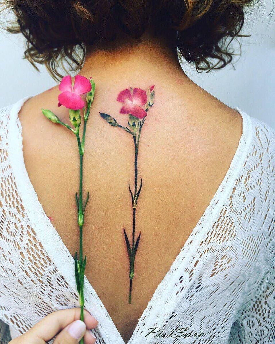 Тату для девушек цветы фото на спине
