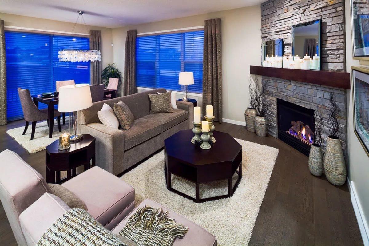 Дизайн гостиной с камином в углу