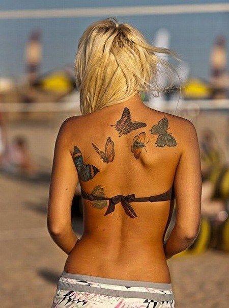 Тата бабочки на пояснице
