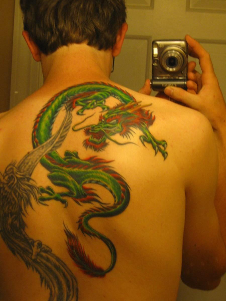 Татуировки цветной дракон фото