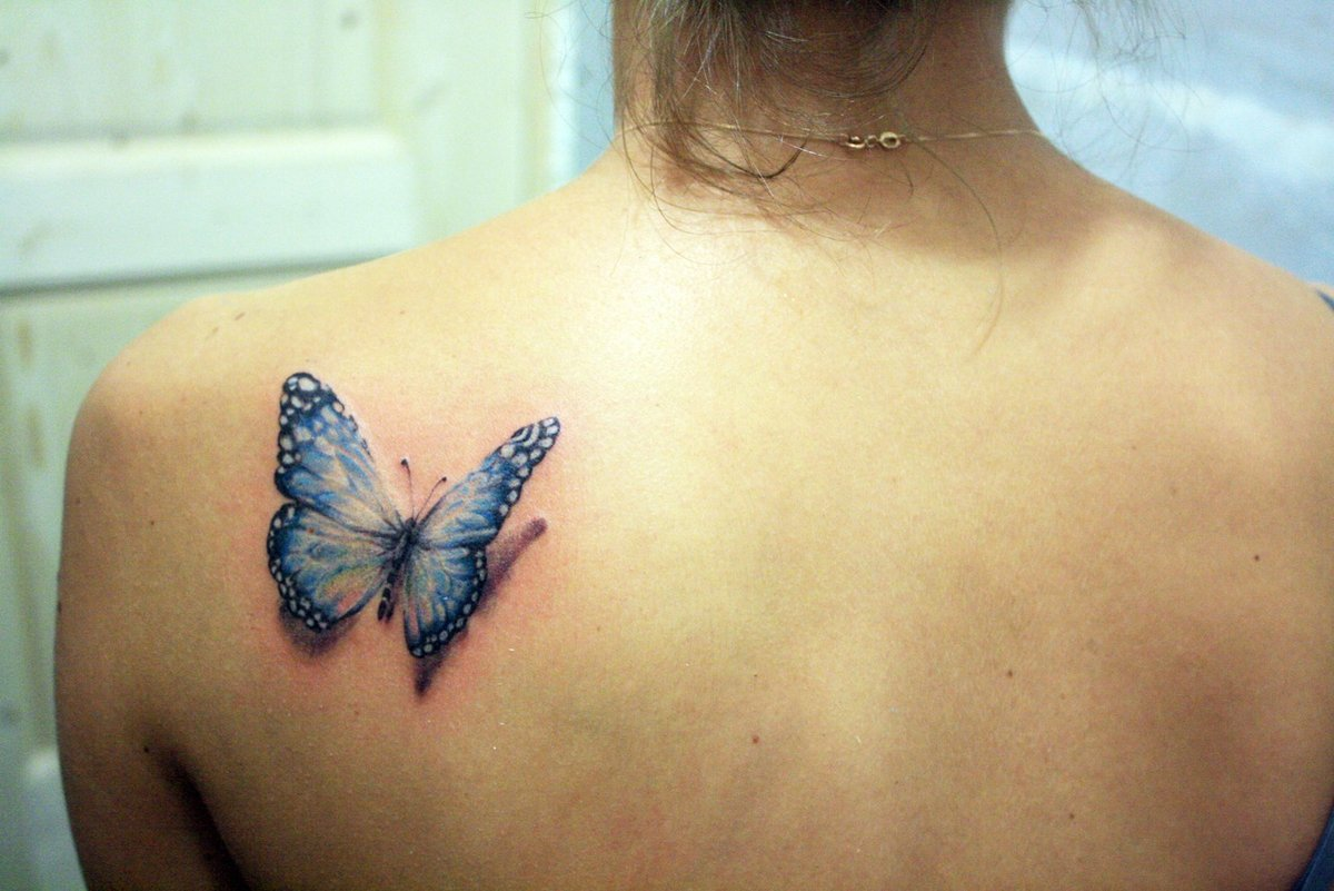 Маленькие татуировки для девушек на спине фото