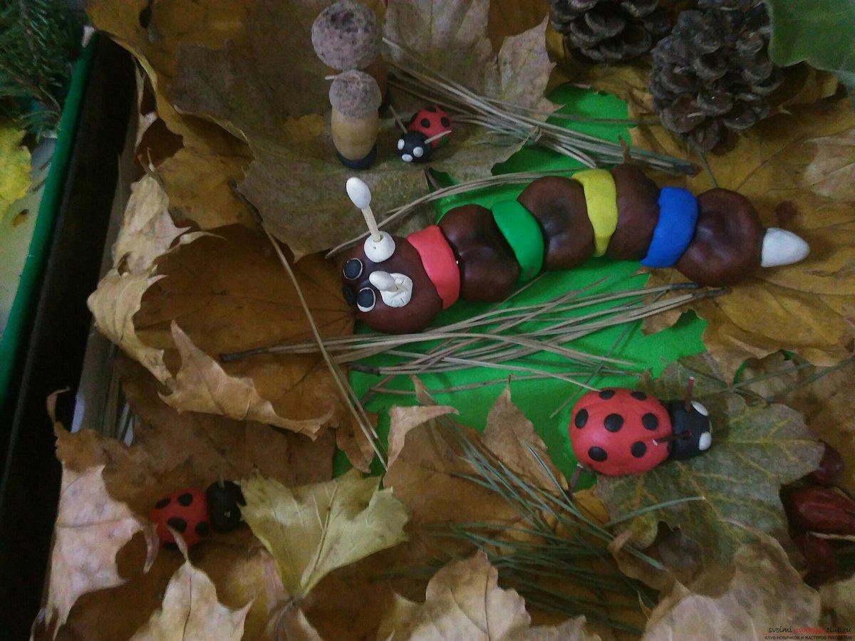 Поделка гусеница своими руками для сада