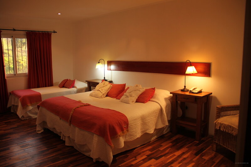 Rio Arriba Suites Apartments y Resto