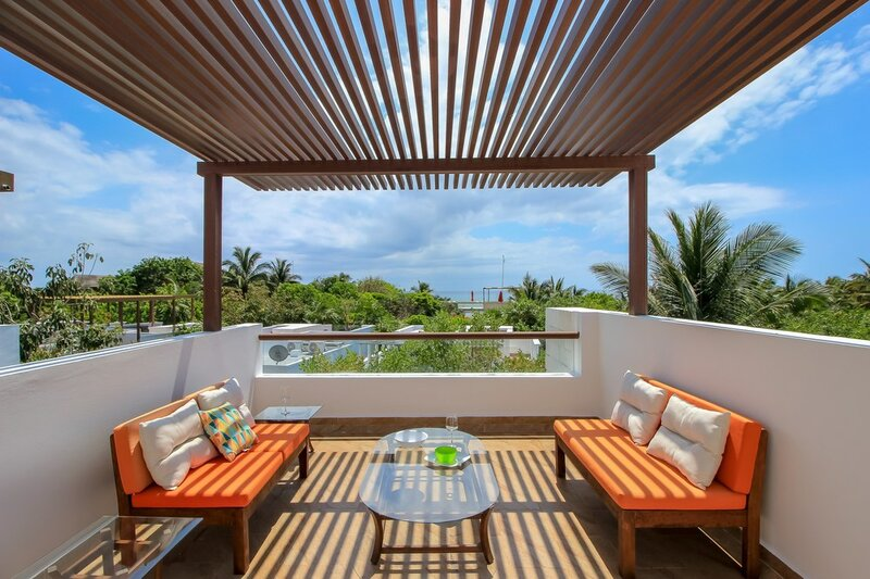 Luxury Home with Rooftop steps away from Beach by Olahola