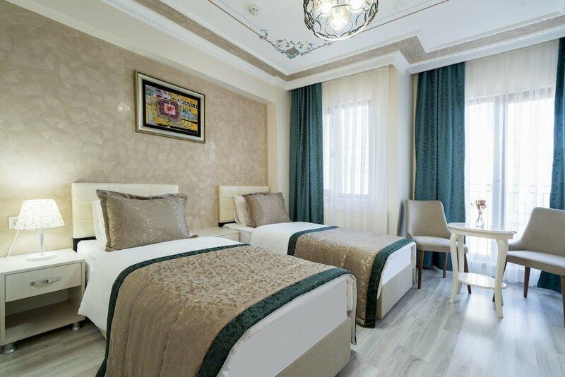 Atam Suites & Apart