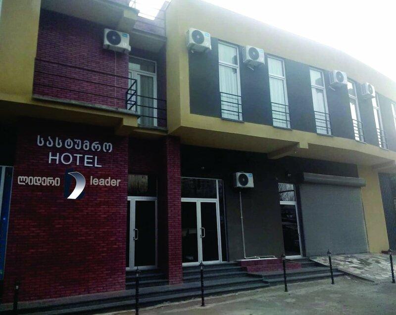 Отель Leader