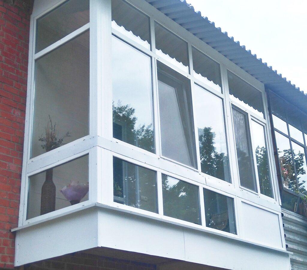 фото балконов из стеклопакета этого ракурса виден