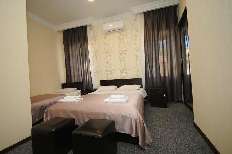 Отель 7 Rooms