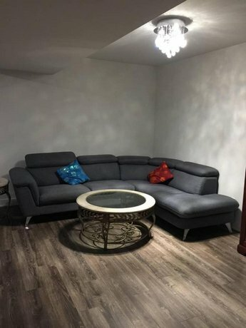 Private room and bathroom with living area in a basement