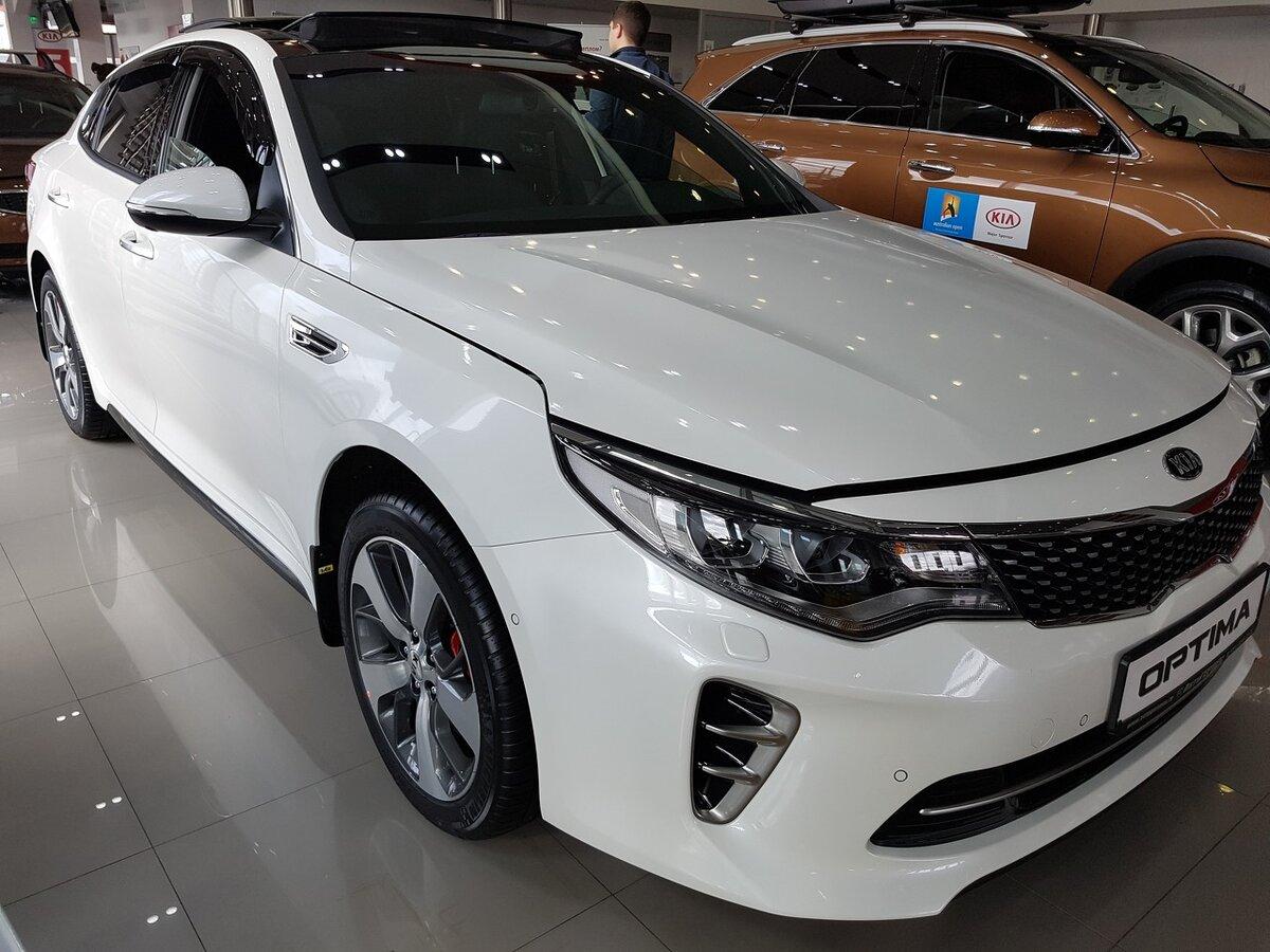 Фото машины киа оптима белая