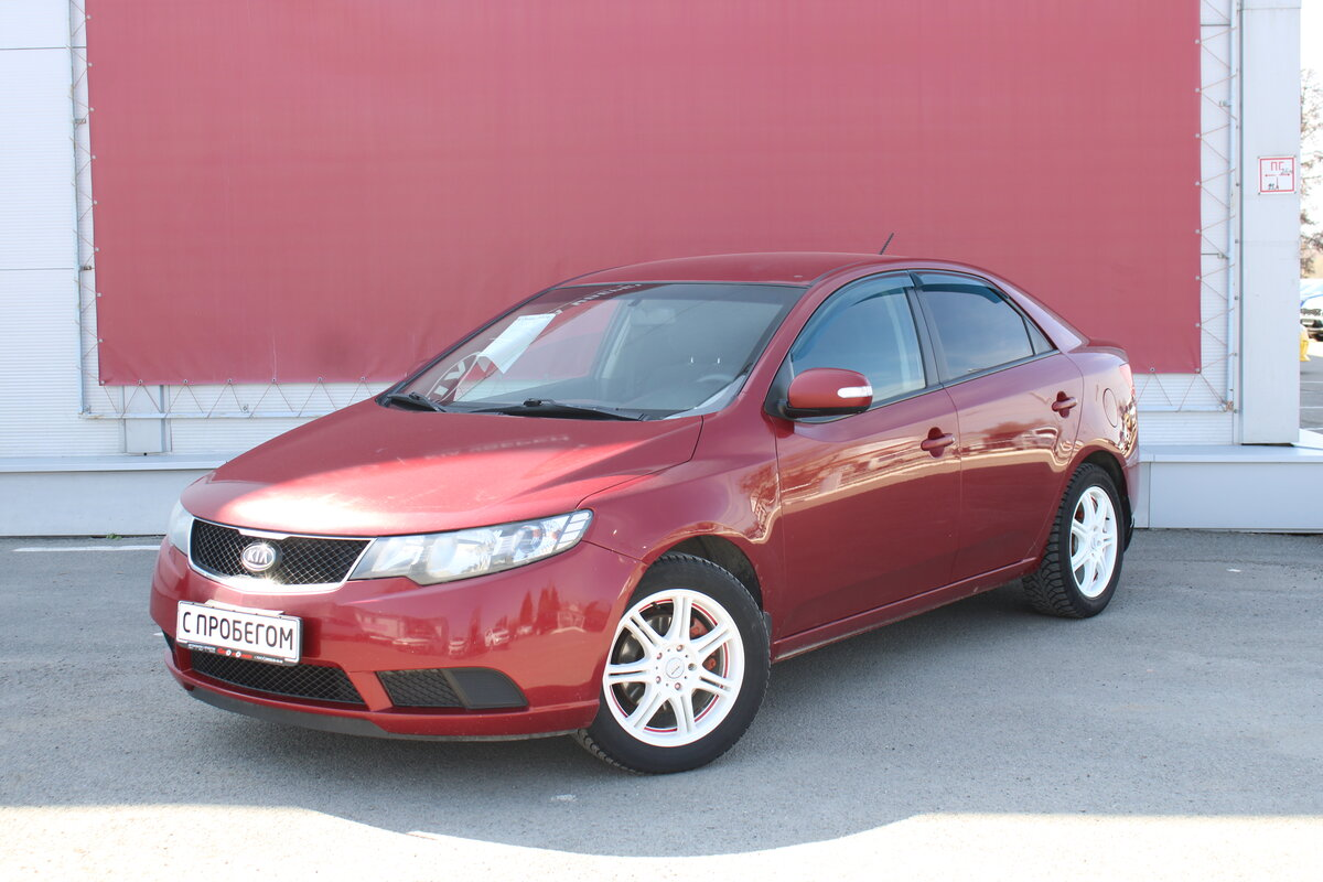 2009 Kia Cerato  II 5-speed, красный