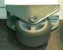 NF-05 Колесо мебельное D=30мм неповоротное на площадке, серая резина