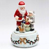 Дед мороз дарит подарки. Музыкальная фарфоровая фигурка. Подарок на новый год. Высота 17 см