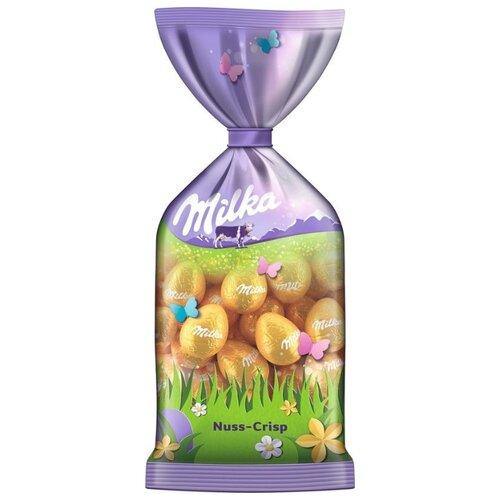 Фигурный шоколад Milka молочный в форме яйца с ореховой начинкой и хрустящими хлопьями фигурный шоколад milka mini eggs молочный в форме яйца в сахарной глазури 24 шт