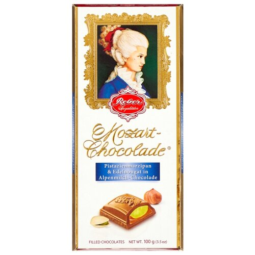 набор конфет reber constanze mozart kugeln с ореховым пралине 120 г Шоколад Reber Mozart AlpenVollmilch молочный с ореховым пралине и фисташковым марципаном, 100 г