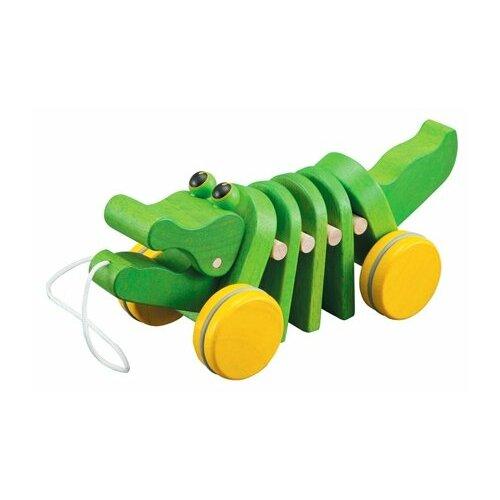 Купить Каталка-игрушка PlanToys Dancing Alligator (5105) со звуковыми эффектами зеленый, Каталки и качалки