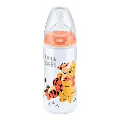 бутылочка для кормления nuk first choice пласт 150 мл с силиконовой насадкой для питья голубая NUK First Choice Plus Дисней-Винни бутылочка с соской 300 мл с рождения, персиковый
