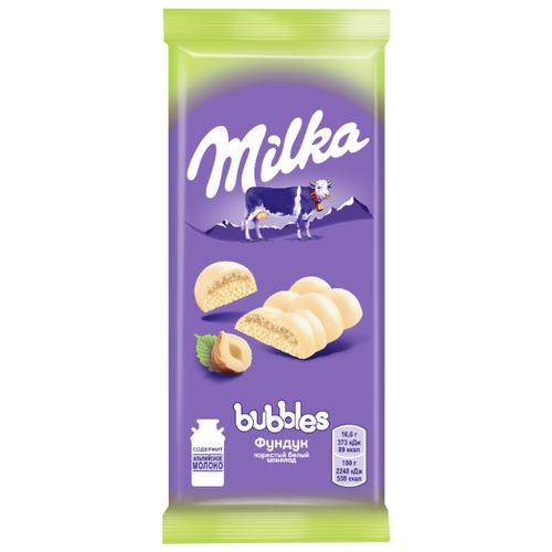 цена Шоколад Milka Bubbles белый пористый с фундуком, 83 г онлайн в 2017 году