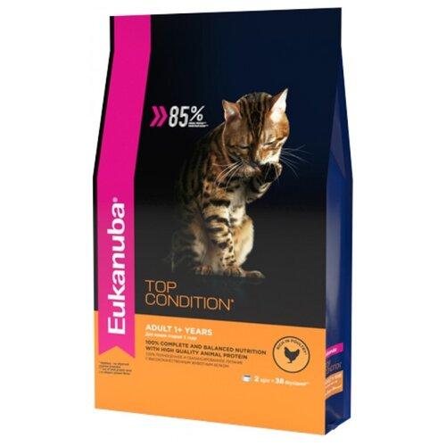 Корм для кошек Eukanuba Top Condition для здоровья кожи и шерсти, домашняя птица 2 кг корм eukanuba для кошек для выведения комков шерсти 2 кг