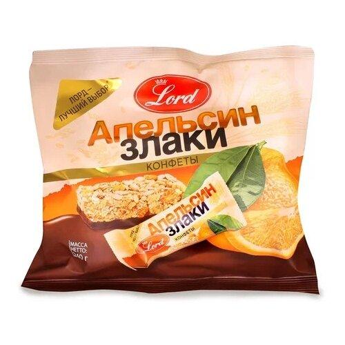 Фото - Конфеты Lord в шоколадной глазури апельсин и злаки 240 г грецкий орех кремлина в шоколадной глазури 135 г