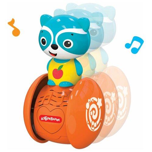 Неваляшка Азбукварик Музыкальные покатушки Енотик 10.5 см голубой/оранжевый