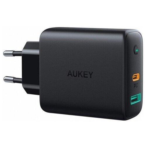 Фото - Сетевое зарядное устройство Aukey Dual-Port Wall Charger PA-D1 30W USB+USB-C, черное сетевое зарядное устройство aukey travel charger pa u32 12w 2xusb a черное