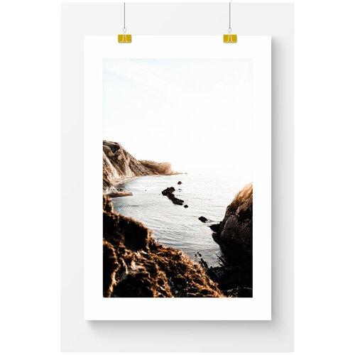 Постер для интерьера Postermarkt Коричневые скалы у моря, 70х100 см, в тубусе скалы у моря