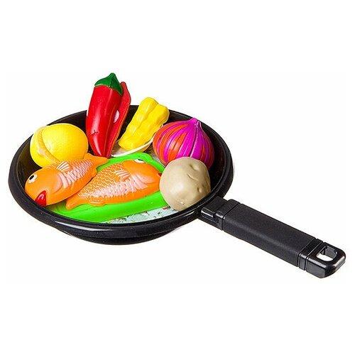 Набор продуктов со сковородкой и фартуком,