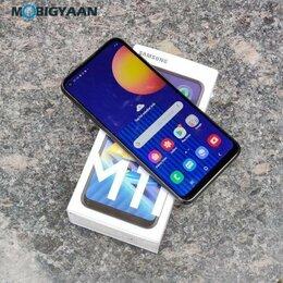 Мобильные телефоны - Samsung M11 32 Gb, 0