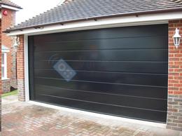 Заборы и ворота - Подъёмно-секционные ворота чёрного цвета, 0