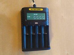 Зарядные устройства для стандартных аккумуляторов - Универсальное зарядное устройство Nitecore UMS4, 0