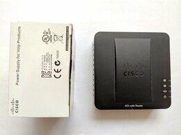 VoIP-оборудование - Адаптер для VoIP-телефонии Cisco SPA122, 0