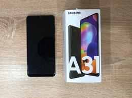 Мобильные телефоны - Телефон Samsung A31, 0