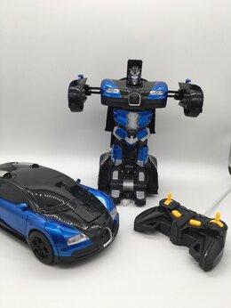 Радиоуправляемые игрушки - Машина-Трансформер с пультом управления и…, 0