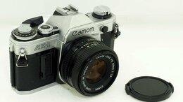 Пленочные фотоаппараты - Фотоаппарат Canon AE-1 с объективом Canon Lens…, 0