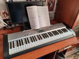 Клавишные инструменты - Синтезатор Casio LK-130, 0